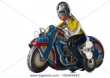 a windup tin toy - motorcyclist