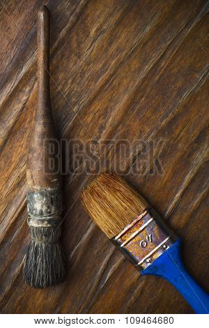two brushes on wood surface