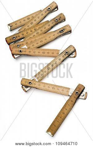 a carpenter's measure on white