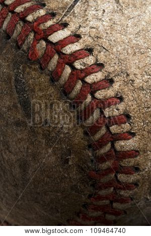 a detail of an old and shabby baseball
