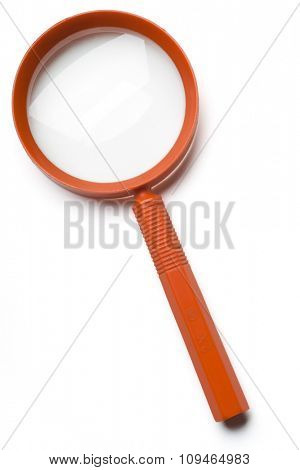 an orange magnifying glass on white