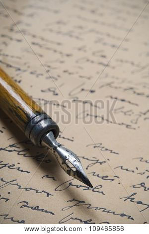 a detail of an old nib on a handwritten letter