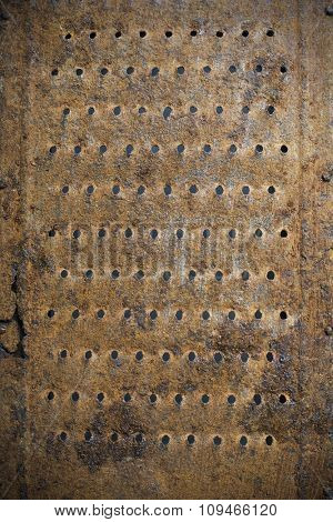 a closeup of an old rusty grater