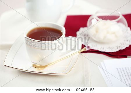 Cup of tea on table close up
