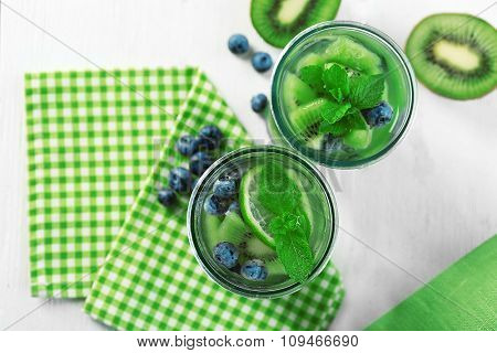 Kiwi and Blueberry cocktails on wooden background