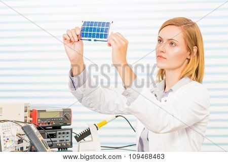 The technician is testing film solar cells