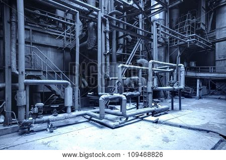 abandoned steel mill with pipes and valves