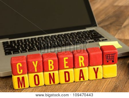 Cyber Monday written on a wooden cube in a office desk