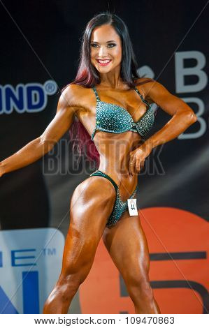 MOSCOW, RUSSIA - NOVEMBER 21, 2015: Elena Gomulina participates in Bodybuilding Champions Cup during SN Pro Expo Forum 2015 on November 21, 2015 in Moscow, Russia