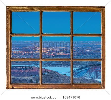 Fort Collins, Colorado, cityscape at night - abstract view from a sash window of old  mountain cabin