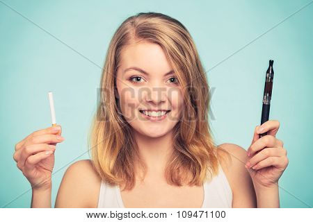 Girl With Normal And Electronic Cigarette.