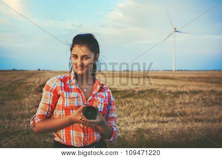 Beautiful woman by wind turbine.