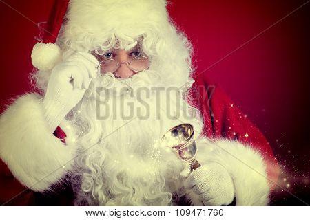 Photo of happy Santa Claus in eyeglasses looking at camera