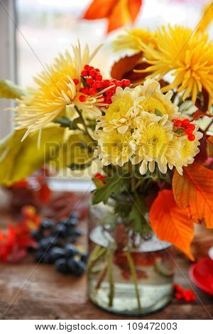 Beautiful autumn bouquet with chrysanthemums flowers, on windowsill