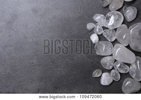 Frame of rock crystal on grey background, copy space