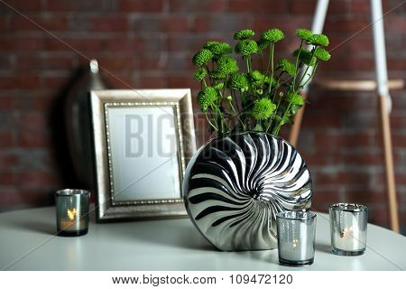 Home decor in a room on a brick wall background