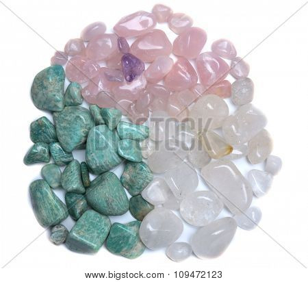 Round shape of mineral stones: azonite, pink quartz, rock crystal isolated on white background