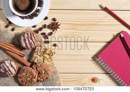 Cookies, Coffee And Notepad On A Table