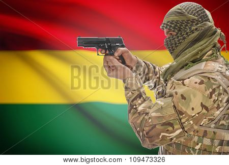 MaleWith Gun In Hand And National Flag On Background - Bolivia