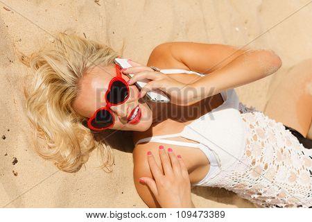 Girl On Beach With Phone.