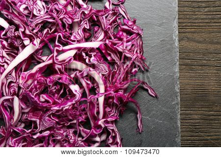 Cut red cabbage on wooden table