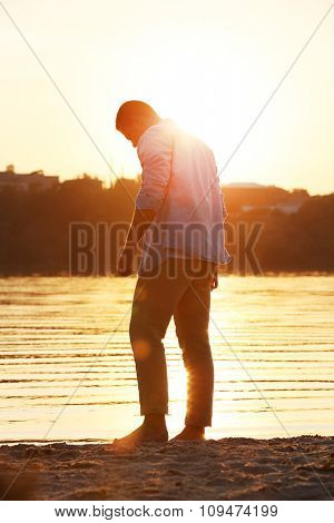 Young man on the riverside