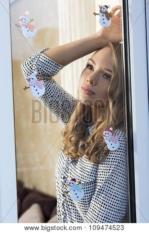 Pretty Woman At Window In Xmas Time