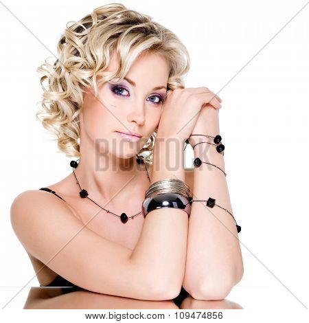 Portrait of blonde beautiful woman with accesorise on her hand
