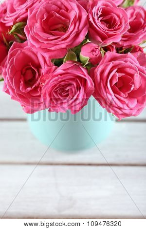 Beautiful roses on wooden background