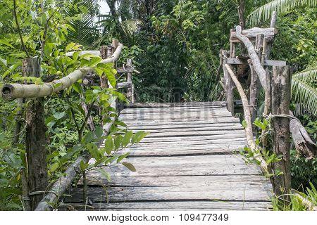 wooden pedestrian bridge across the river