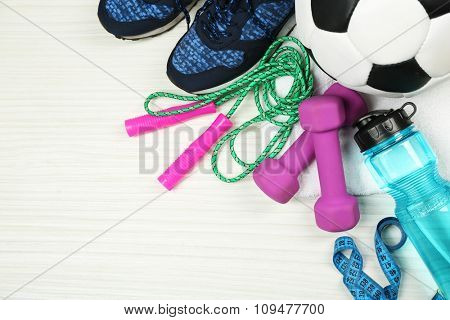 Sport shoes, equipment on light background