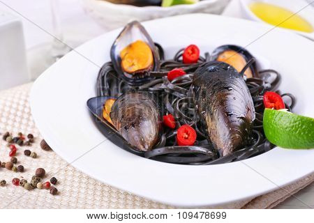 Cooked pasta, mussel and lime on the table, close-up