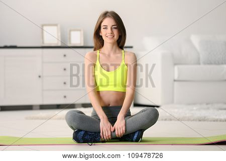 Sports young girl at home