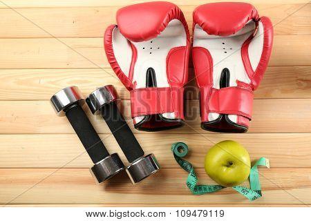 Sport equipment on wooden background