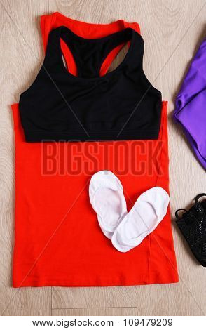 Sport equipment for woman  on wooden background