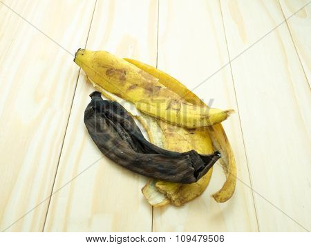 Dried Banana Peels On Wood Table.