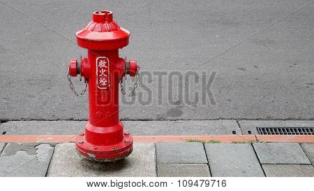Red fire hydrant on street in Taipei