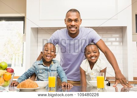 Casual happy family having breakfast in the kitchen