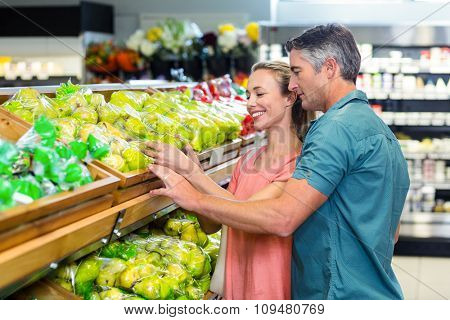 Side view of an happy couple at the supermarket
