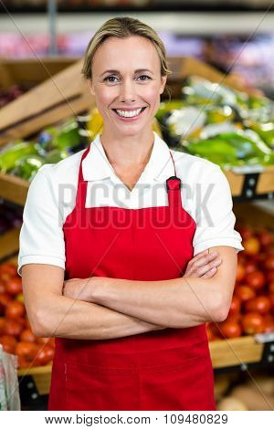 Portrait of smiling woman wearing apron at supermarket