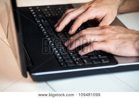 Man using his laptop at a desk