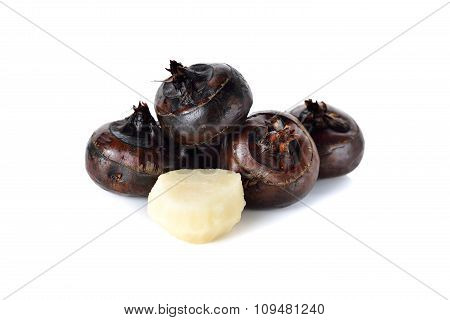 Whole And Peeled Chinese Water Chestnut Or Waternut On White Background