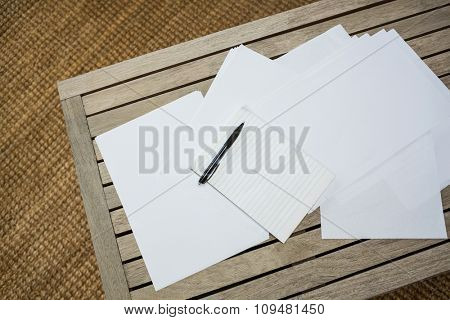 Papers on wooden table in living room