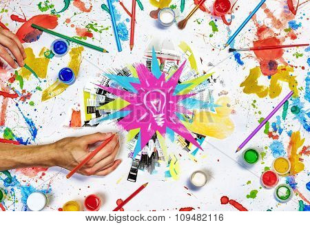 Top view of people hands drawing business creative concept with paints