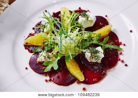 salad of red beets and feta cheese with olive oil