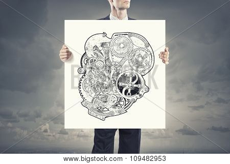 Unrecognizable businessman showing banner with gears mechanism concept