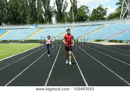Young people jogging on stadium