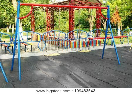 Empty seat of swings on children playground in park