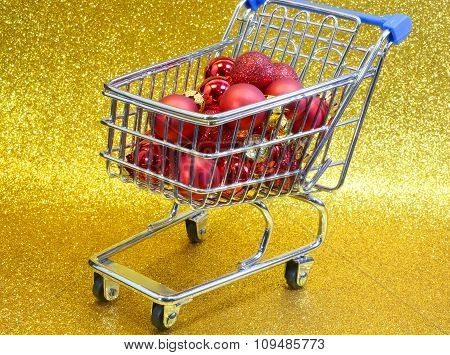 Shopping Cart With Red Decorative Christmas Balls