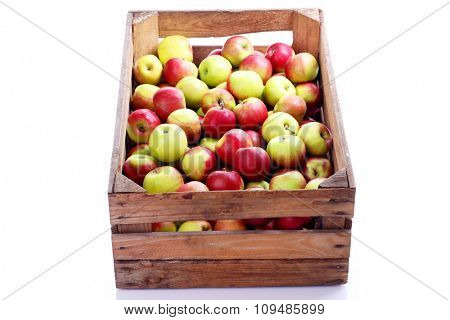 wooden crate box full of fresh apples on white - fruits and vegetables